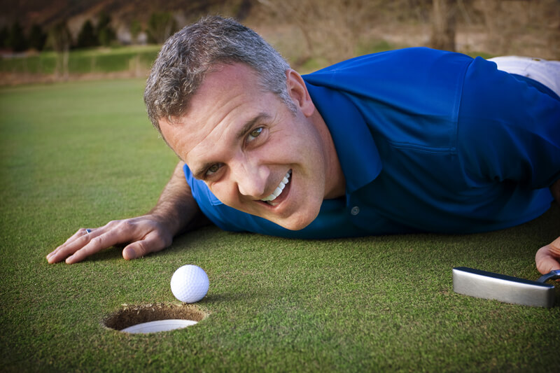 Man playing golf, promoting retirement
