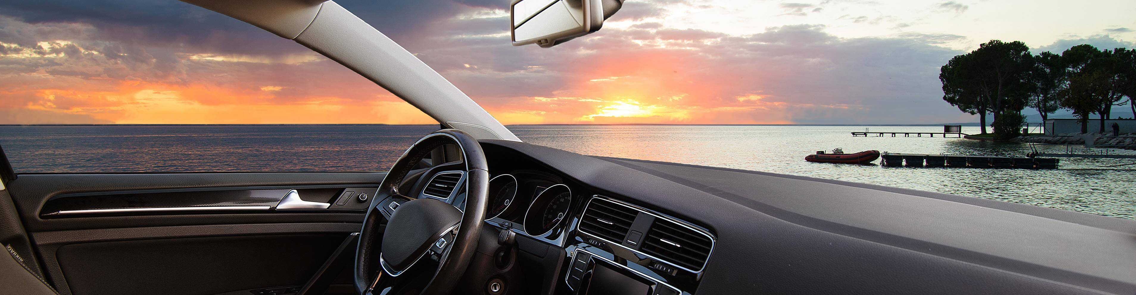 Scenic shot from inside a car looking at sunset